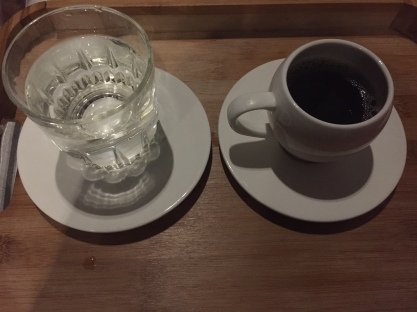 glass of water and a cup of hot tea
